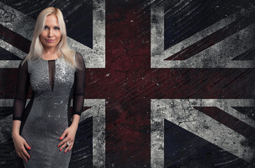 beautiful blonde woman over Grungy UK Flag
