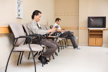 Patients Waiting In Hospital Lobby