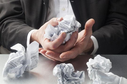 scrap paper balls in hands
