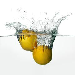 Fresh Lemons Splash in Water Isolated on White Background