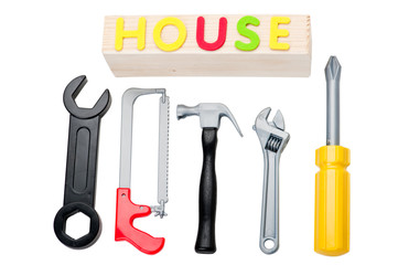 Toy tools and house sign