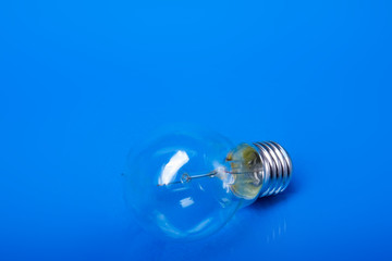 A light bulb, isolated on blue background.