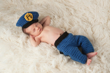 Newborn Baby Boy in Policeman's Uniform