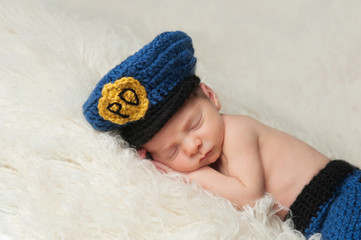 Newborn Baby Boy in Policeman's Hat