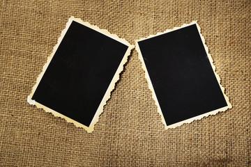 Blank old photos on sackcloth background