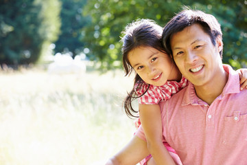Portrait Of Asian Father And Daughter In Countryside