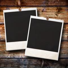 polaroid originali su fondo legno