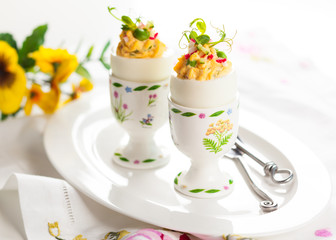 Stuffed eggs in egg cups