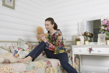 Portrait of a young woman in an interior children's room