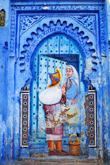 Painting wall at Uta El-Hammam square in Chefchaouen, Morocco