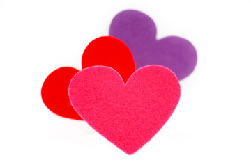 Three colored heart shapes