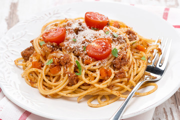 a plate of spaghetti bolognese, close-up