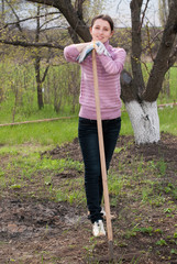 Young woman with onion at garden - Garden works