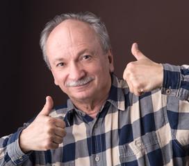 Happy elderly man showing ok sign