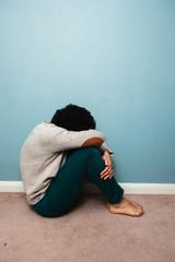 Sad man sitting on the floor