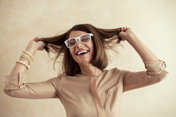 Happy excited woman dancing cheerful with wind in the hair on be