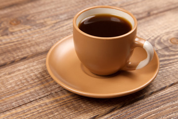 Coffee cup on a wooden table