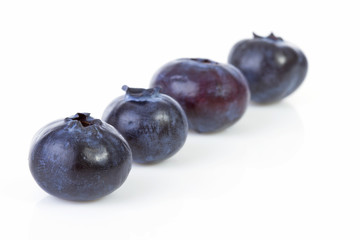 Four black currant berries in a row