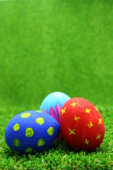Easter eggs on grass background