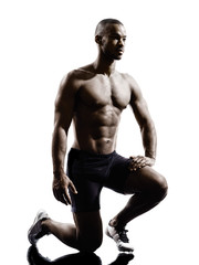 Wall Mural - young african muscular build man silhouette