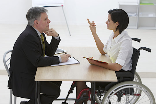 disables business woman in recruitment meeting