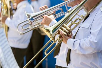 Musicians with trombones