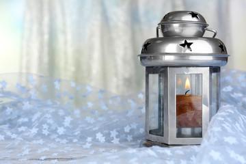 Decorative metallic lantern on fabric background