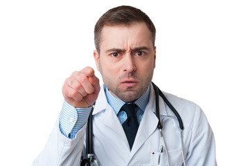 Doctor pointing at you and camera isolated on white background