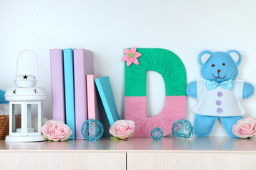 Shelf decorated with handmade knit letter