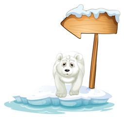 A polar bear below the wooden arrowboard