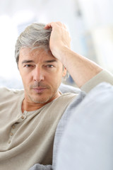 Portrait of attractive mature man relaxing at home