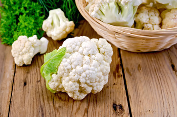 Wall Mural - Cauliflower with a basket on the board