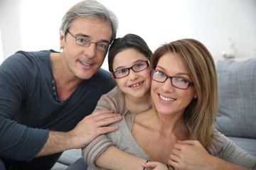 Portrait of family of 3 people wearing eyeglasses