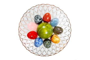 various colorful stone eggs in the vase