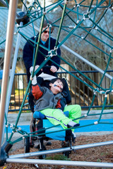 Father with disabled boy at the playground