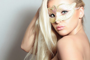 Beautiful Blond Woman in Gold Mask.Holiday Carnival Masquerade