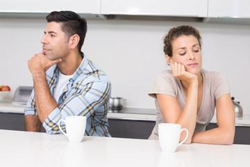 Unhappy couple having coffee not talking