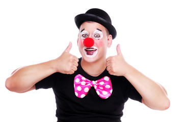 Wall Mural - Happy clown showing thumbs up gesture