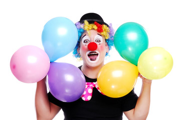Wall Mural - Happy clown holding colorful balloons