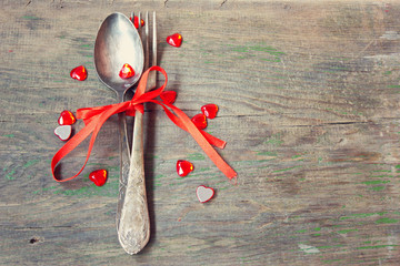vintage fork and spoon with red ribbon and hearts