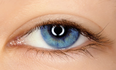 blue eye of a young girl