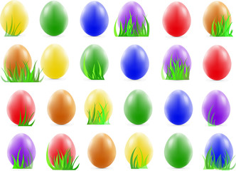 many nice easter eggs on the green grass