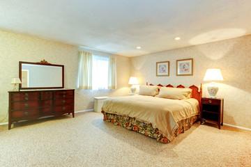Soft colors bedroom wtih antique furniture
