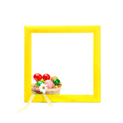 Painted wooden frame with basket of easter eggs