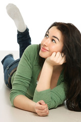 A smiling woman is lying on the floor over white background