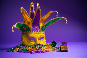 Wall Mural - Assorted Mardi Gras or Carnivale mask on a purple background
