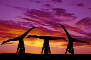 Silhouette dance handstands