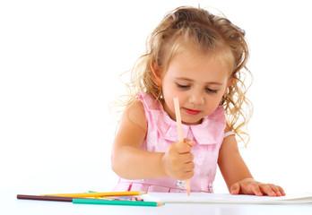 Beautiful smiling girl draws pencil