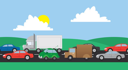 Cars and trucks in traffic on a road