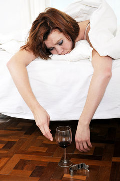 red hair woman with hangover after drinking wine